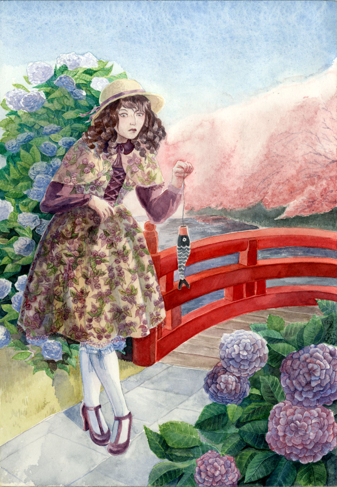 A classic lolita in Japan is holding a paper koi, japanese symbol for boys, before a background setting consisting of a red bridge, hydrangeas, and cherry blossoms.